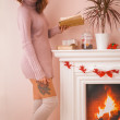 Hot woman with book at home at Christmas time — Stock Photo