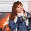 Girl near fireplace — Stock Photo
