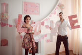 Loving couple with love letters — Stock Photo