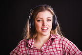 Woman in checkered shirt — Stock Photo
