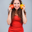 Woman with bell peppers — Stock Photo