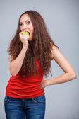 Girl bites apple — Stock Photo