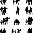 Silhouette of parents and children — Stock Vector