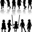 Group of children's silhouettes — Stock Vector