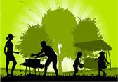Family picnic in the garden — Stock Vector
