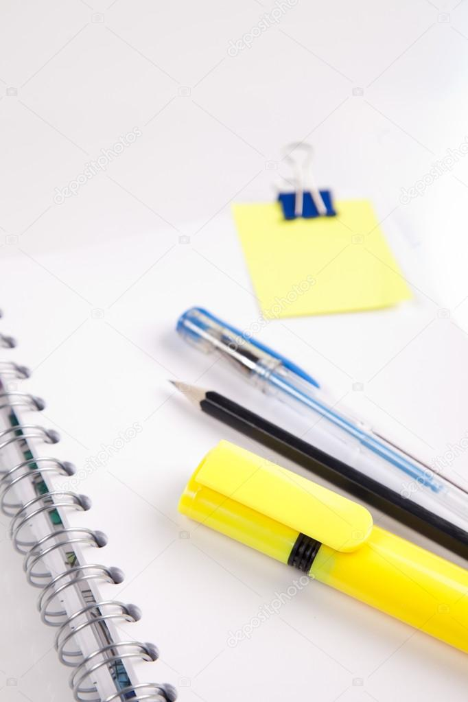 Offide accessories isolated on white background with notebook — Stock Photo #12873277