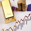 Gold bars on charts! - Stock Photo