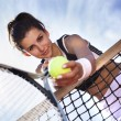 Beautiful young girl rests on a tennis net — Stock Photo #30264167