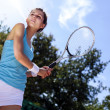 Young girl playing tennis at the beautiful weather — 图库照片