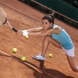 Young girl playing tennis at the beautiful weather — Stock Photo #30264547