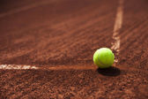 Tennis ball in the line — Stock Photo