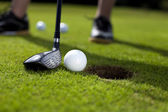 Closeup of hole on golf field — Stock Photo