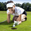Pretty girl cheating on golf field — Stock Photo