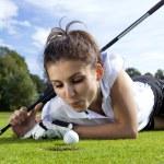 Pretty girl cheating on golf field — Stock Photo