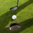 Closeup of hole on golf field — Stock Photo