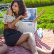 Pretty girl make a picnic — Stock Photo