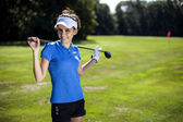 Portrait of a woman playing golf — Stock Photo