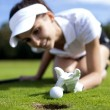 Pretty girl cheating on golf field — Stock Photo #32022713