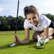 Pretty girl cheating on golf field — Stock Photo #32022759