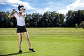 Pretty girl playing golf on grass — Stock Photo