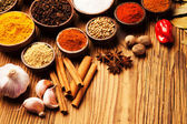 Spices and herbs in wooden bowls. — Stock Photo