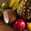 Super tasty tropical fruits on wooden table — Stock Photo