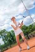 Kobieta, grać w tenisa — Zdjęcie stockowe