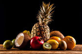 Super tasty tropical fruits on wooden table — Foto de Stock