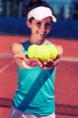 Female playing tennis — Zdjęcie stockowe