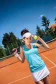 Weibliche tennis spielen — Stockfoto