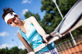 Female playing tennis — Stock Photo