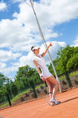 Female playing tennis — Stock Photo
