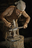 Medieval blacksmith — Stock Photo