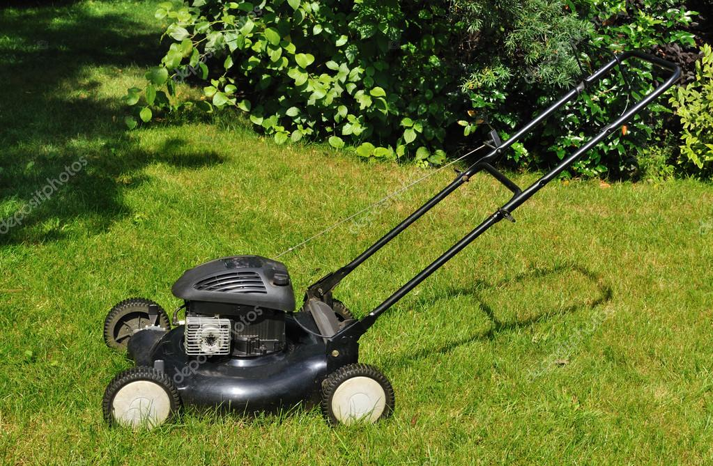 Lawn mower in the garden. — Stock Photo #12091806