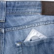 Close-up old jeans and a condom in his back pocket — Stock Photo