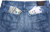 Jeans with currency in their pockets — Stock Photo