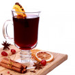 Glass of mulled wine and ingredients on a wooden table — Stok fotoğraf
