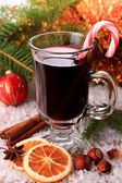 Mulled wine with candy stick — Stock Photo