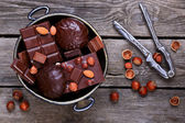 Vase with chocolate and nuts — Stockfoto
