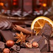 Mixture of pieces of chocolate spices and nuts , selective focus — Stock Photo #34815573