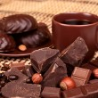 Crushed chocolate on a background coffee cup , selective focus — Stock Photo