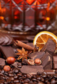 Mixture of pieces of chocolate spices and nuts , selective focus — Stock Photo