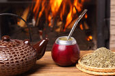 Mate in the calabash, kettle, yerba on fire background — Stock Photo