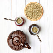 Yerba mate and calabashes on a light wooden background, top view — Stock Photo
