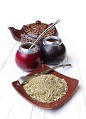 Yerba mate and calabashes on a light wooden background — Stock Photo