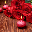Romantic composition with red candles and roses. selective focus — Stock Photo #38626673