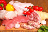 Fresh raw meat - beef, pork, chicken and vegetables — Stock Photo