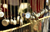Old antique pocket watch on the market — Stock Photo