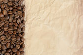 Background from coffee beans and old paper — Stok fotoğraf