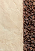 Background from coffee beans and old paper — Stock Photo